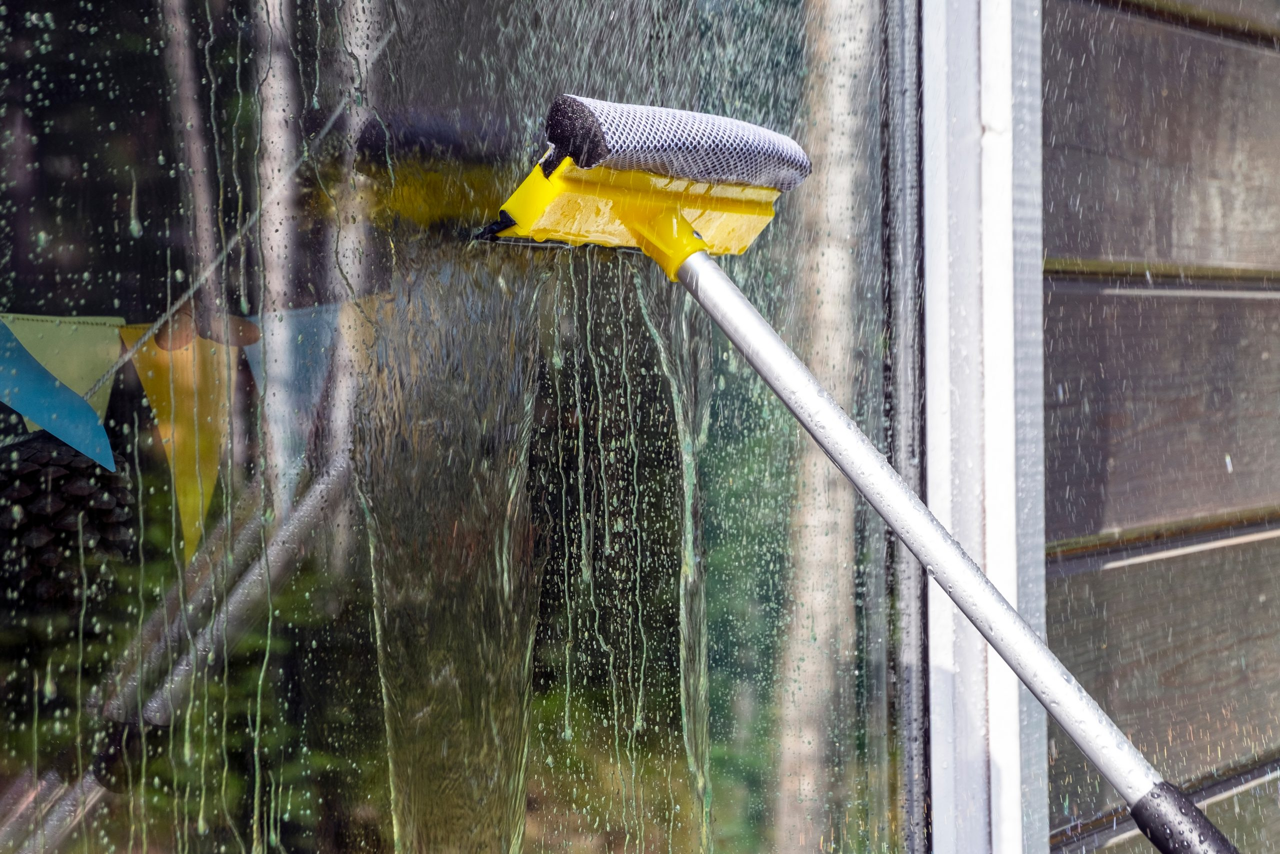 using-a-squeegee-to-wash-a-window