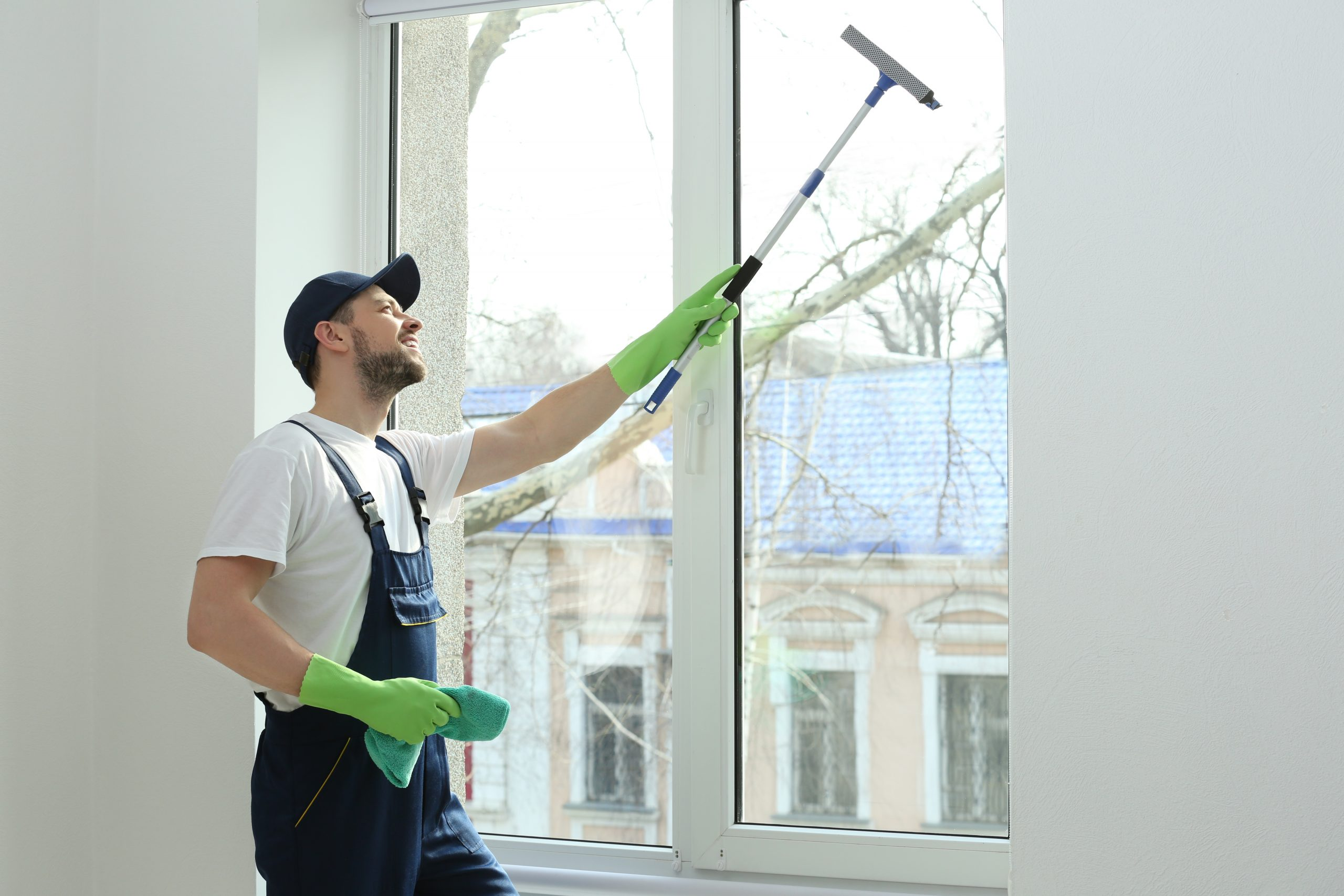 residential-window-cleaning-expert-working-on-an-interior-window