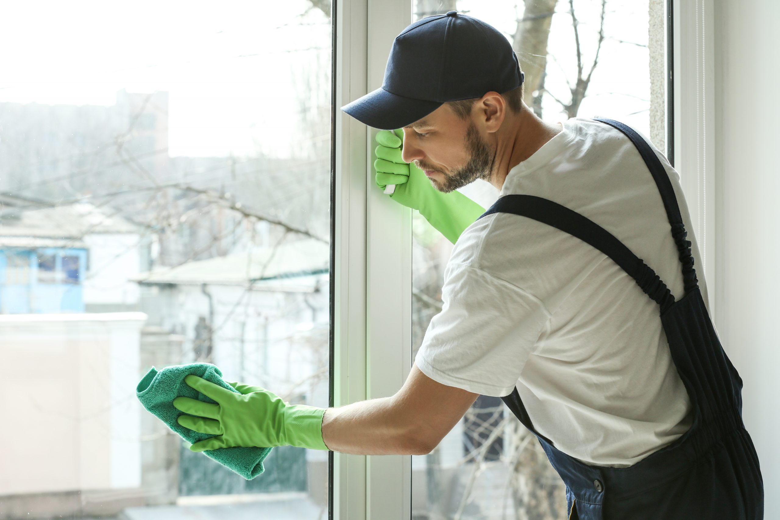 residential-window-cleaning-employee-drying-window
