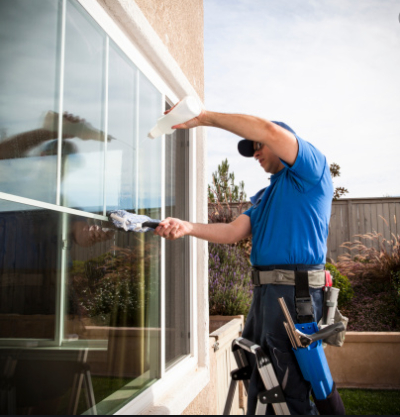 professional-window-cleaner-working-on-outside-of-a-home