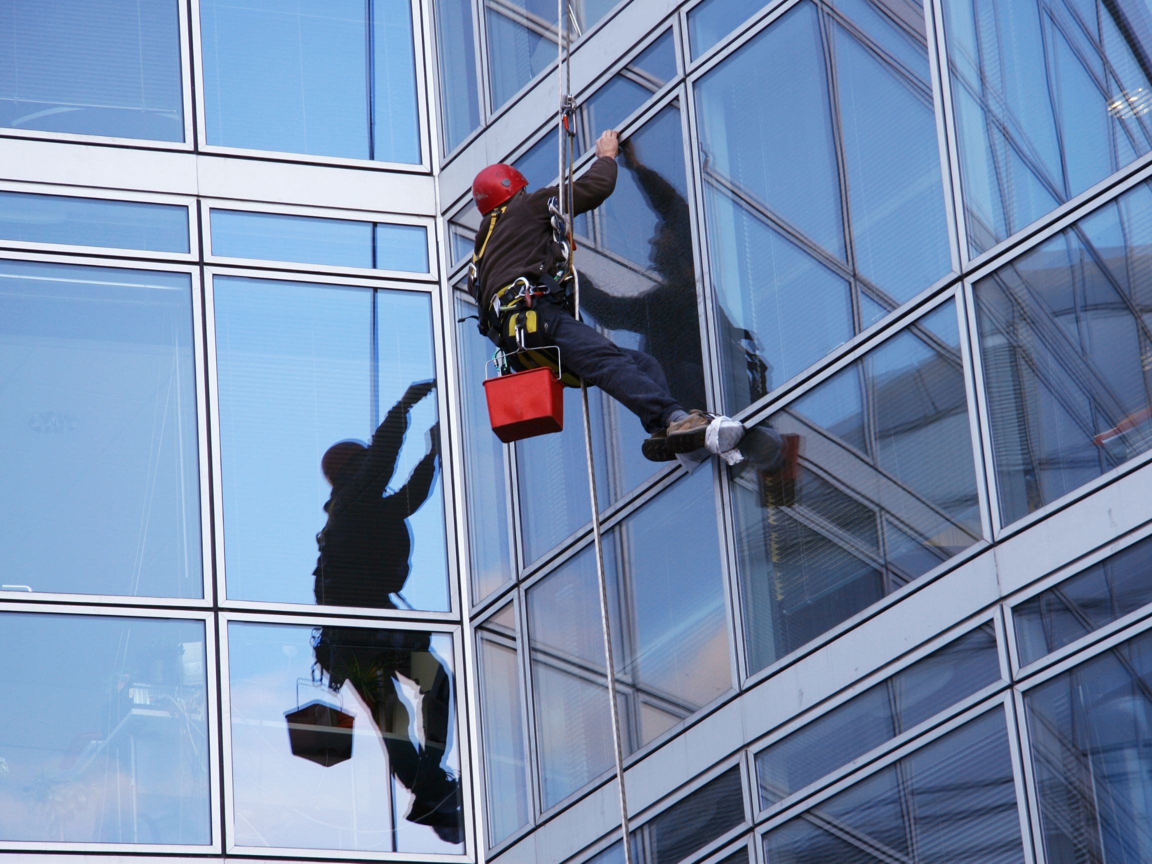 Commerical-window-cleaner-working-on-angled-building